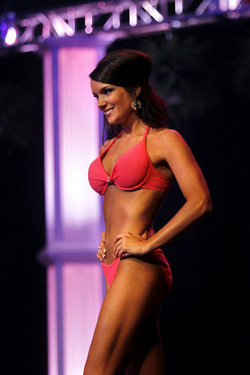 Miss Stateline Cassandra Kramer poses during the swimsuit competition during the Miss Michigan Preliminary Night on Thursday at Frauenthal Center for the Performing Arts in downtown Muskegon. Ashley Miller | MLive Date Shot 06142012