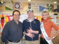 Gonzo, iSteve and Miss Michigan Nicole Blaszczyk celebrate after their pancake-eating challenge at IHOP this morning.