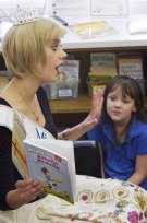 Miss Michigan, Nicole Blaszczyk, reads Amelia Bedelia to Sharon Fortier's third-grade class. Katherine Derscha listens closely. (photos by Bill Bresler | staff photographer)